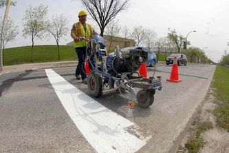 The concrete canvas – a look at how the City paints Winnipeg's streets