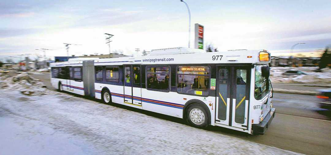 PHOTOS BY Phil Hossack / Winnipeg Free Press  Winnipeg TransitÕs articulated buses, purchased from Ottawa and refurbished here, were bargains at $53,000 each.