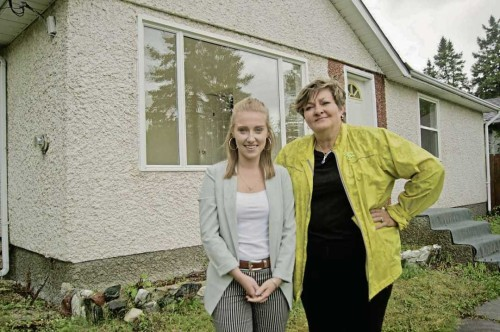 Aug. 23, 2017 - South Winnipeg-St. Norbert city councillor Janice Lukes (right) poses with summer intern Hailey Hooke outside of a suspected rooming house on Grierson Avenue in Fort Richmond. The two are working on creating an inventory of illegal rooming houses in the neighbourhood and are compiling data to help curb the conversion of single family homes to rental revenue properties. (DANIELLE DA SILVA/CANSTAR/SOUWESTER)