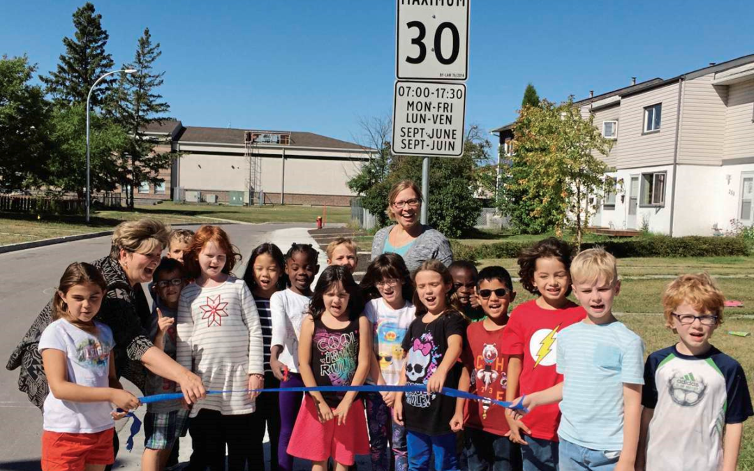 Students at Parc La Salle Celebrate New Sidewalk on Houde Drive