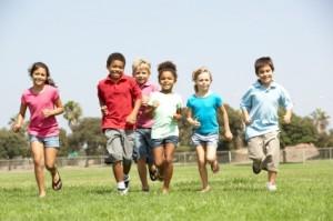 Group Of Children Running In Park