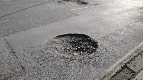Potholes and Road Repair Strategies